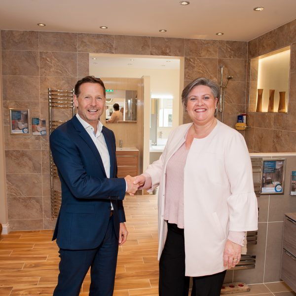 Coucnillor Roz McCall opens the Haddow Bathrooms showroom extension with managing director Lawrence Haddow